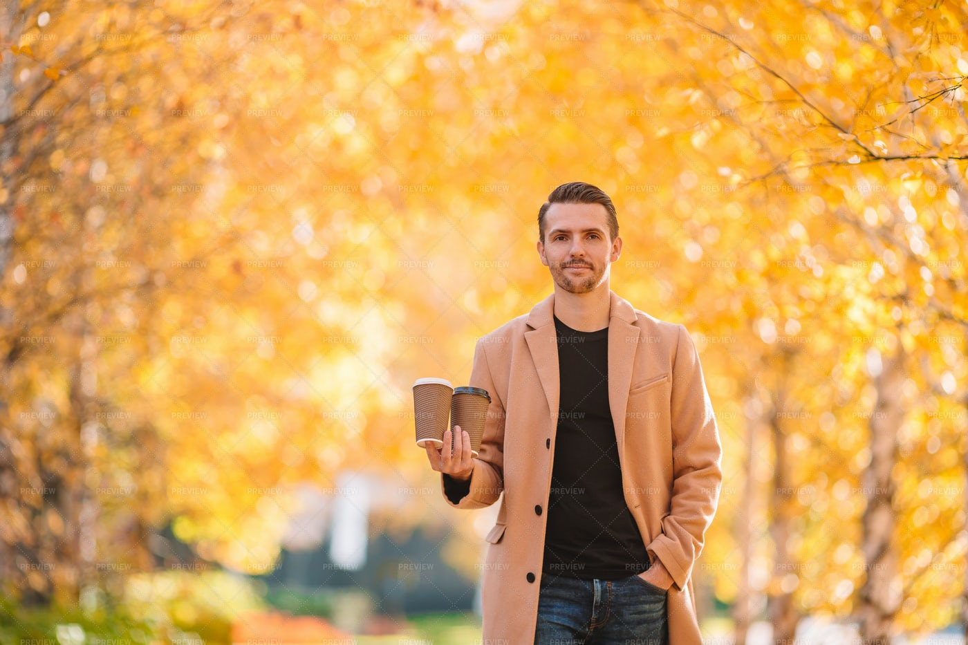 Holding Two Coffee Cups: Stock Photos