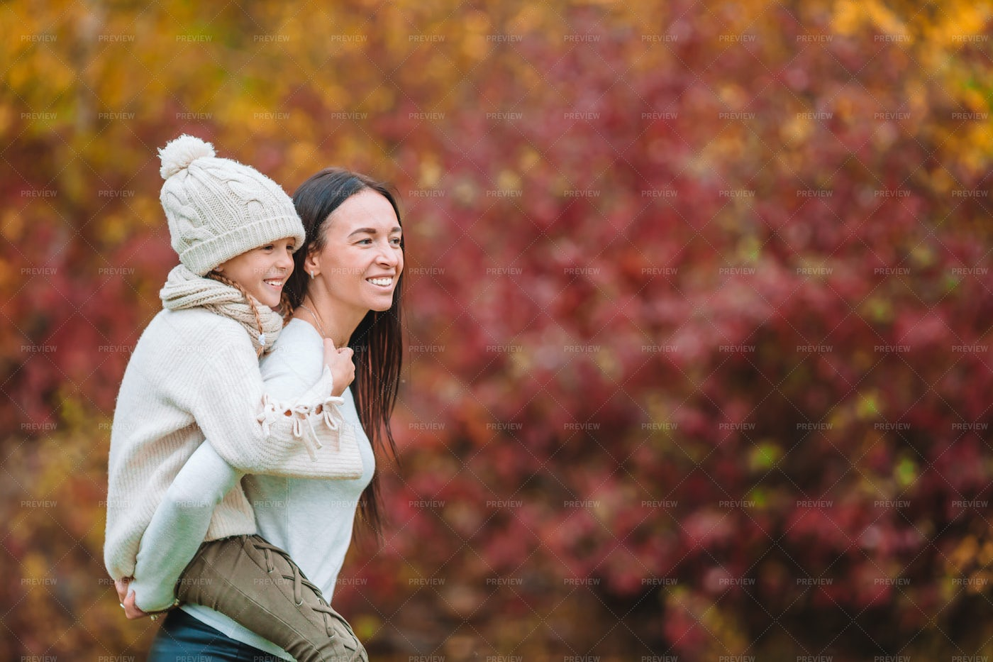 Mother Carrying Her Daughter: Stock Photos
