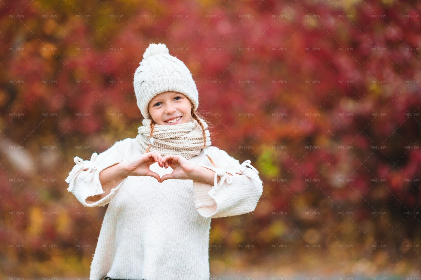 Girl Making Heart Symbol: Stock Photos