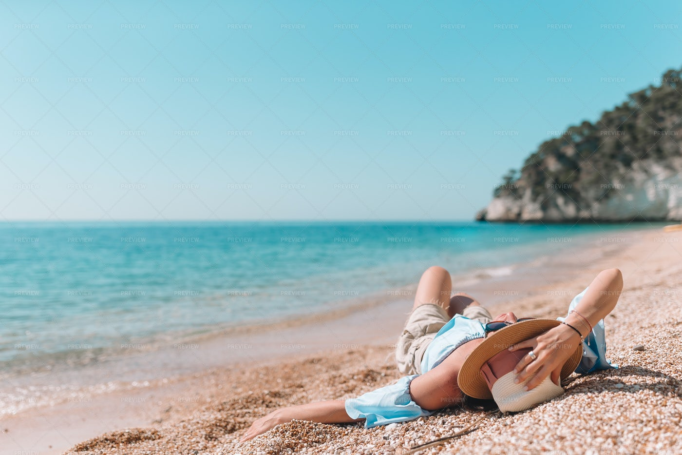 Woman Laying On The Beach: Stock Photos
