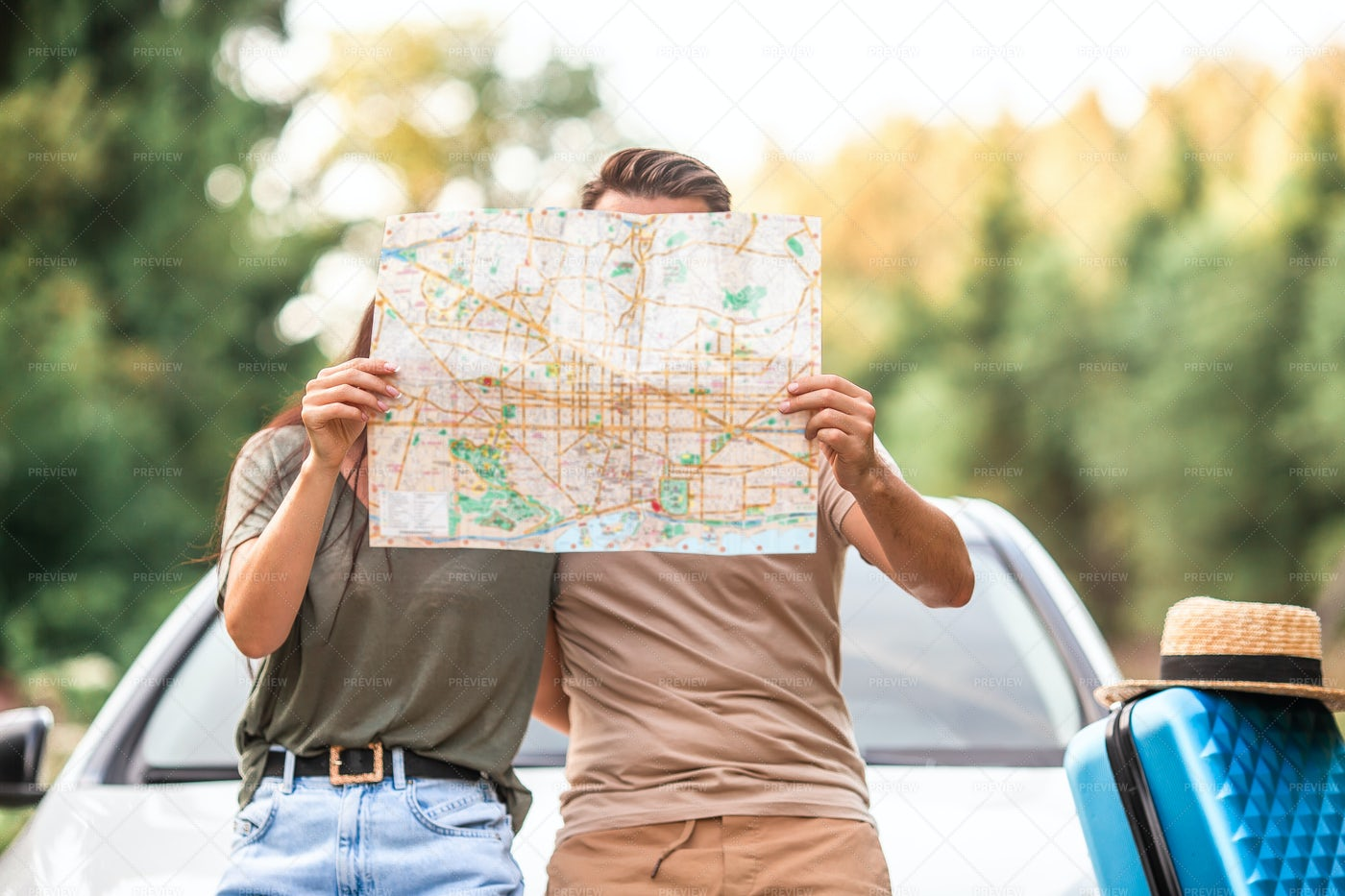 Couple With Map On Road Trip: Stock Photos