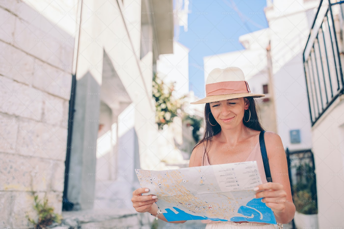 Tourist Consults Italian Map: Stock Photos