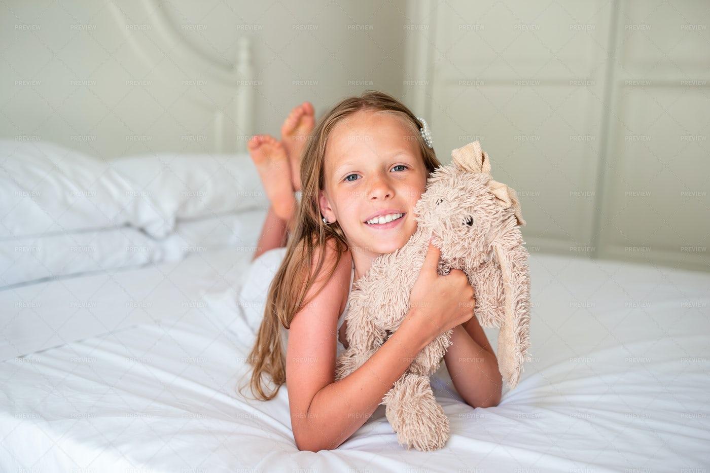 Girl With Stuffed Rabbit Toy: Stock Photos
