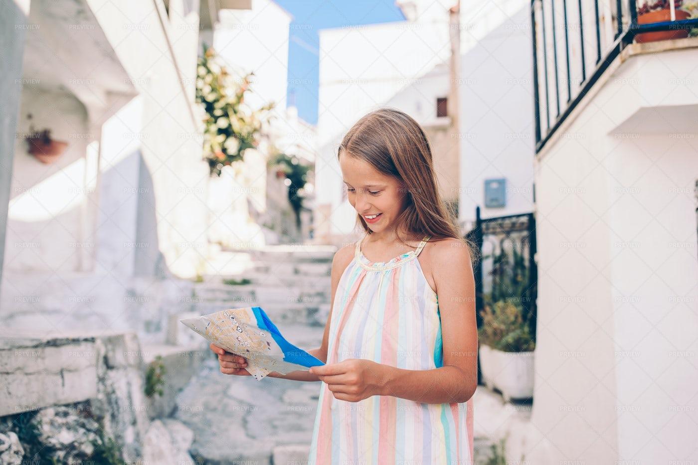 Tourist Girl With A Map: Stock Photos