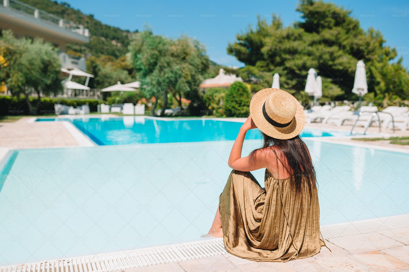 Sitting By The Pool: Stock Photos