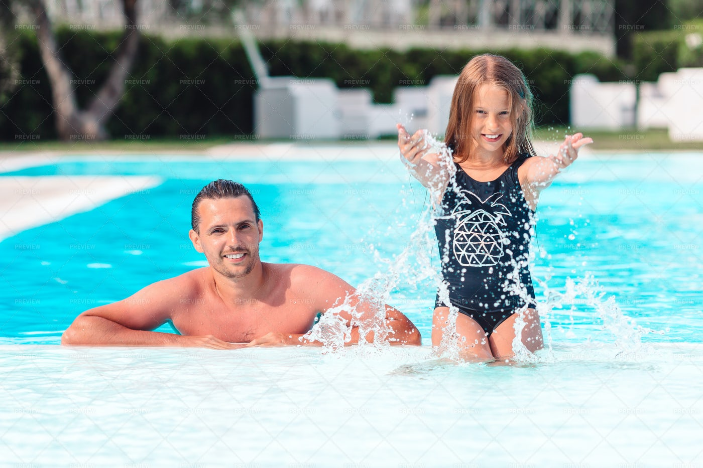 Father And Daugher In The Pool: Stock Photos