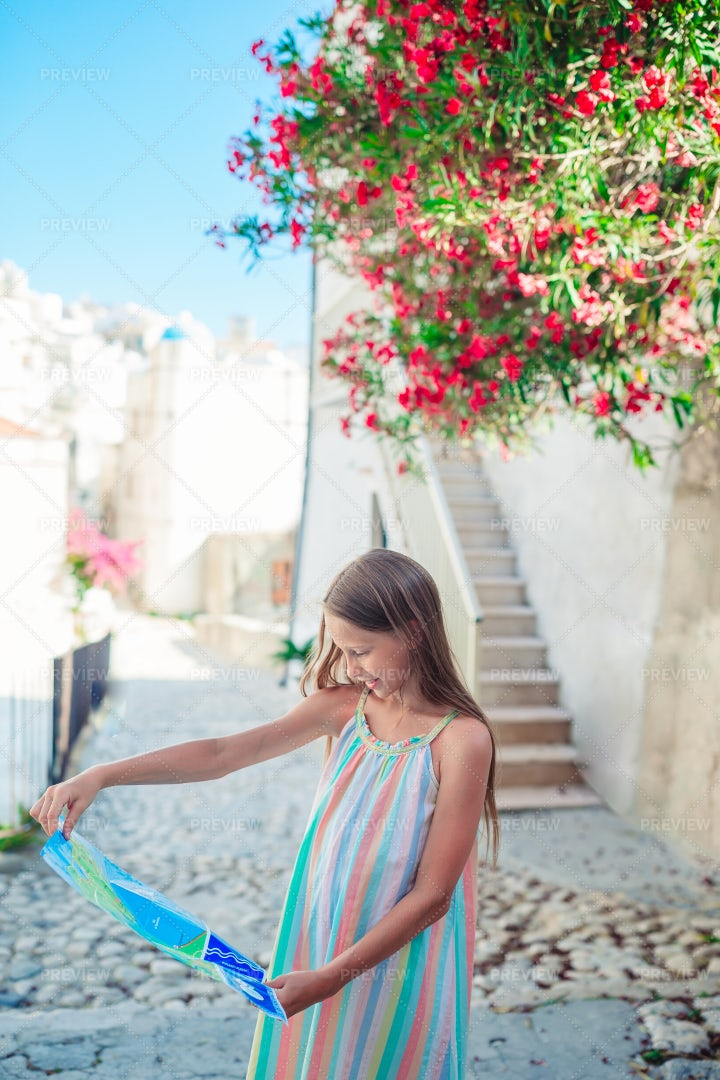 Kid With Map Of Italian Town: Stock Photos