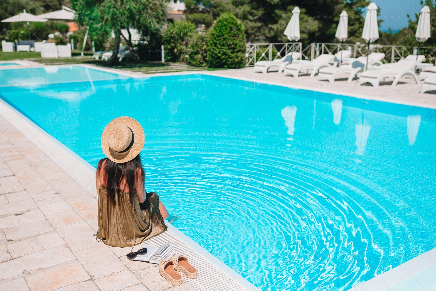 Woman Relaxing By The Pool: Stock Photos