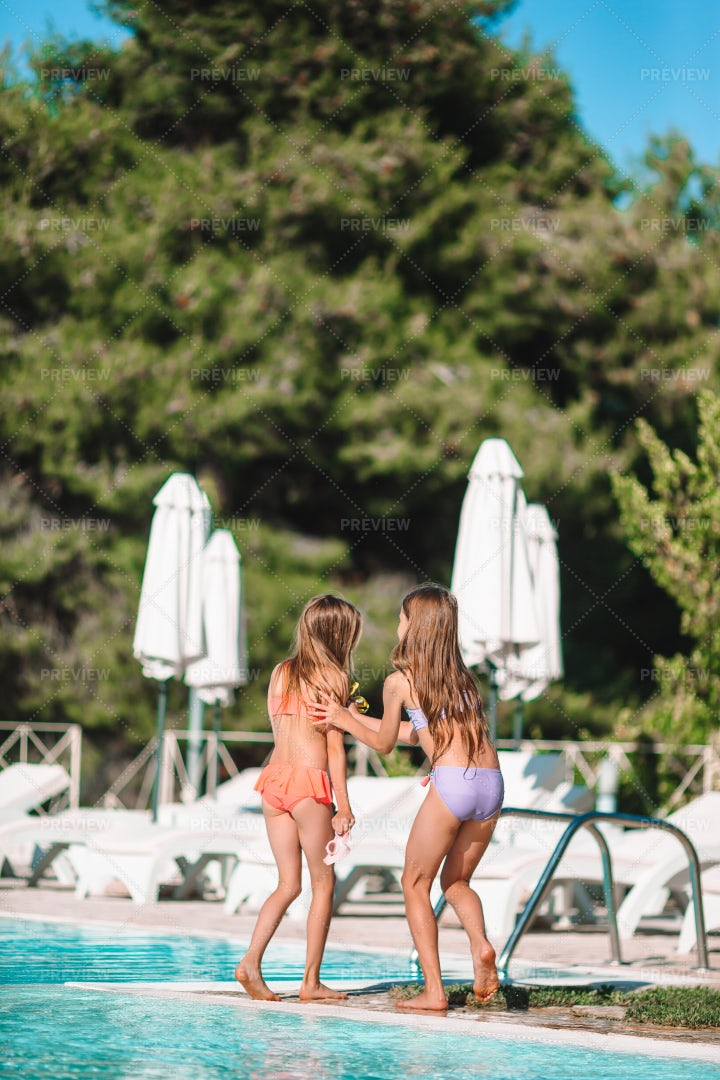 Girls Playing In A Pool: Stock Photos