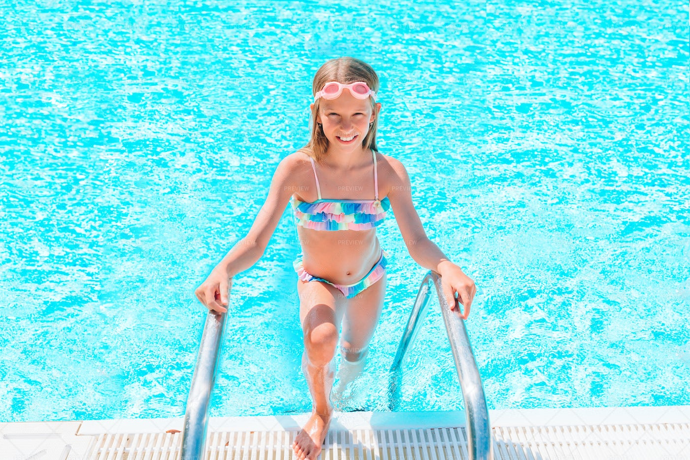 Happy Girl In A Swimming Pool: Stock Photos