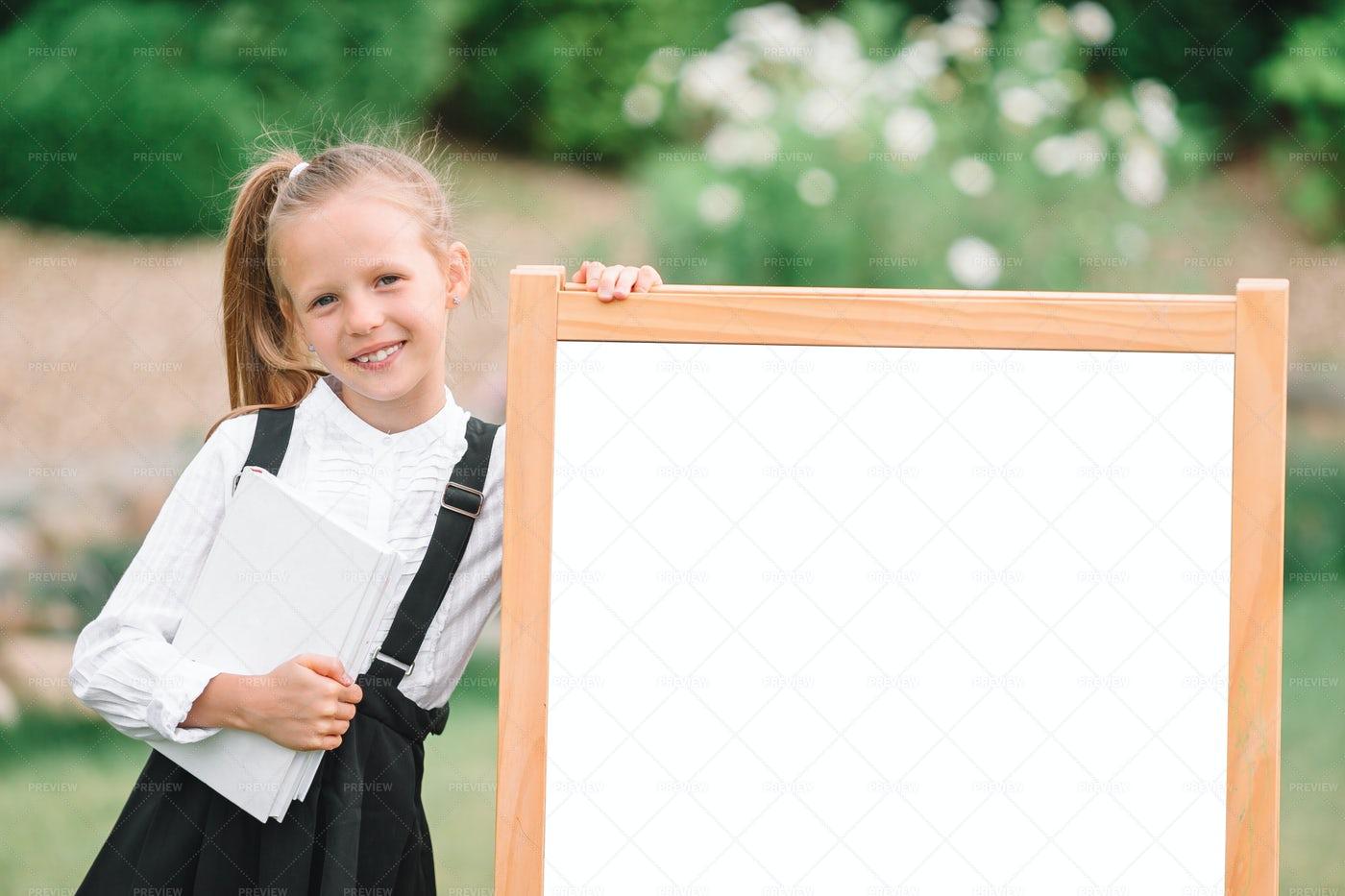 Schoolgirl With An Acrylic Board: Stock Photos