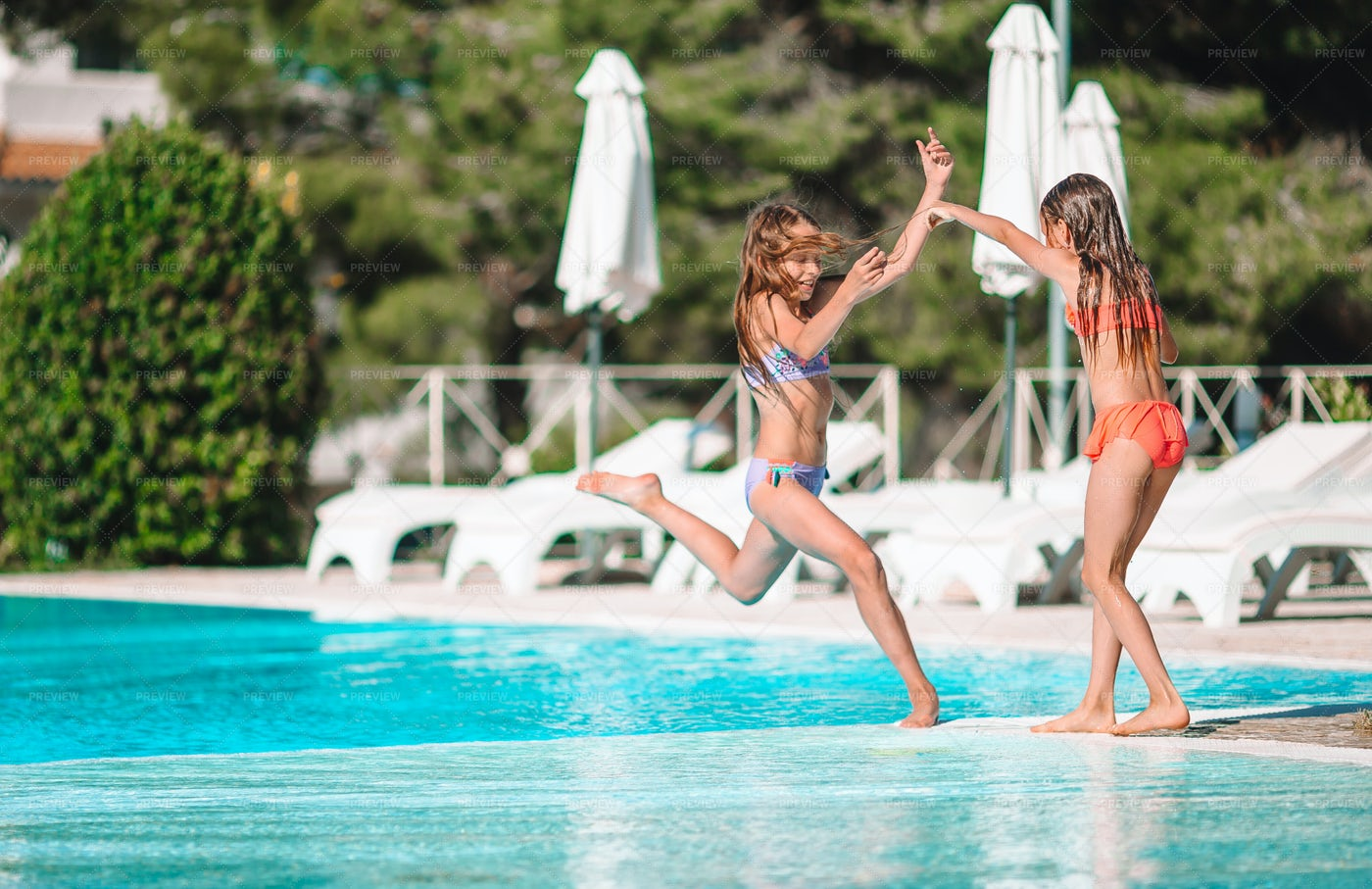 Sisters Play In The Pool: Stock Photos