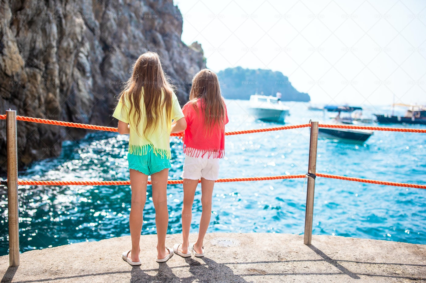 Little Girls In Emerald Grotto: Stock Photos
