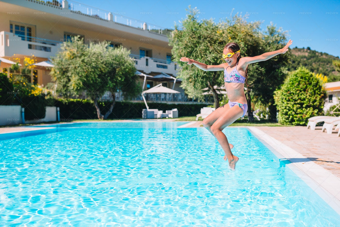 Throwing Herself Into The Pool: Stock Photos
