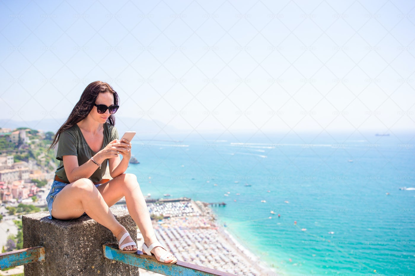 Woman Sitting On Balcony: Stock Photos