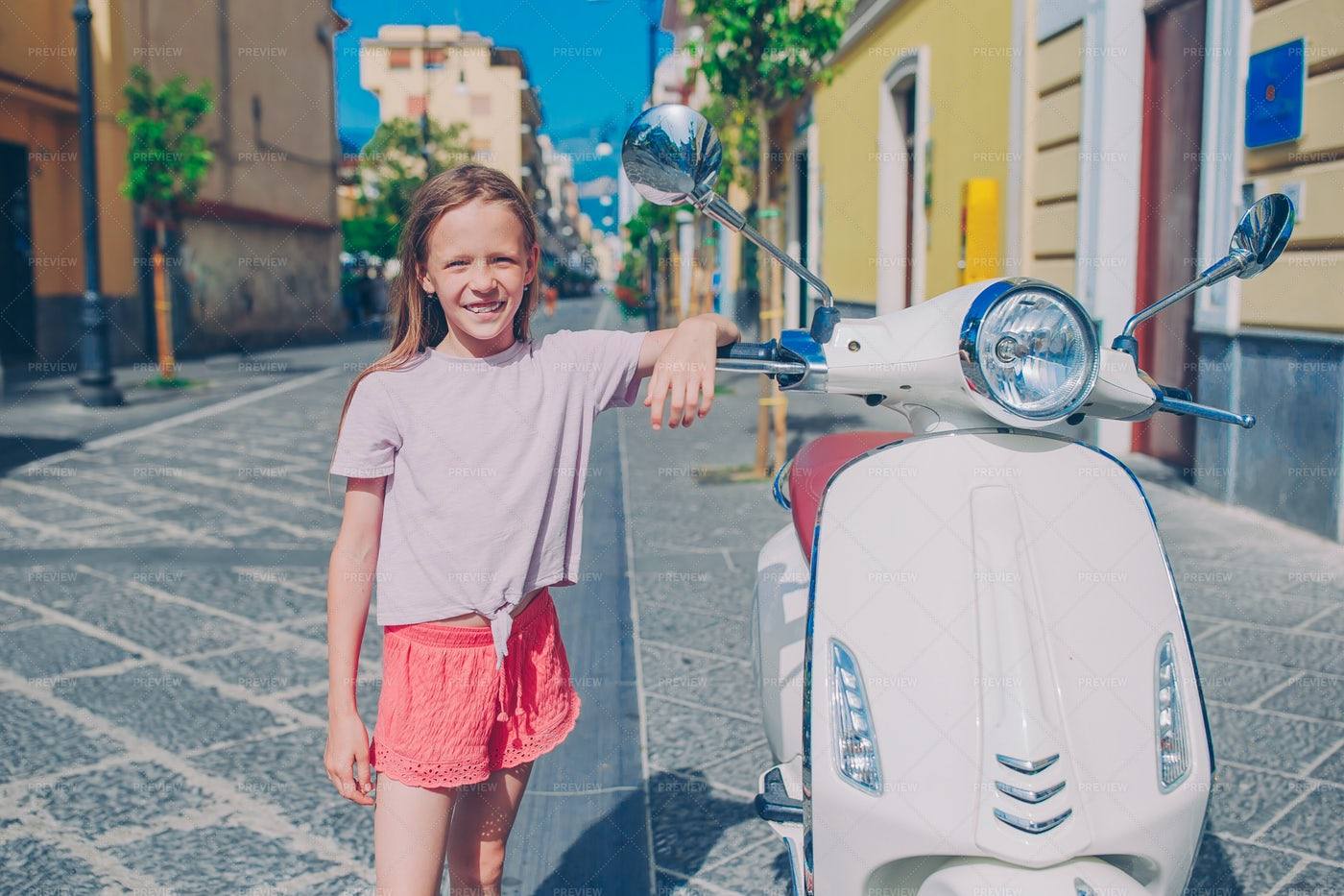 Little Girl Next To A Scooter: Stock Photos