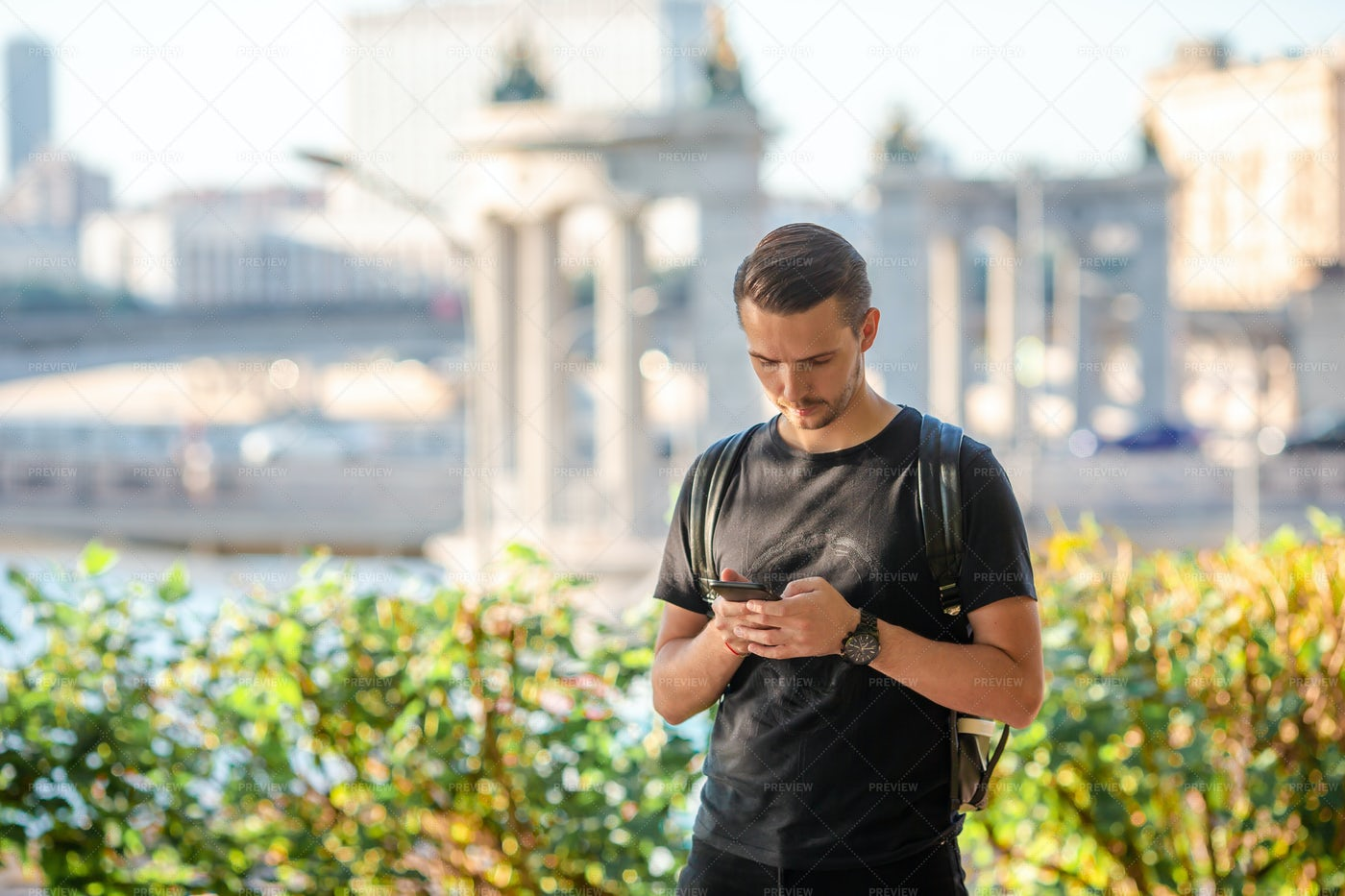 Tourist With Smartphone And Backpack: Stock Photos