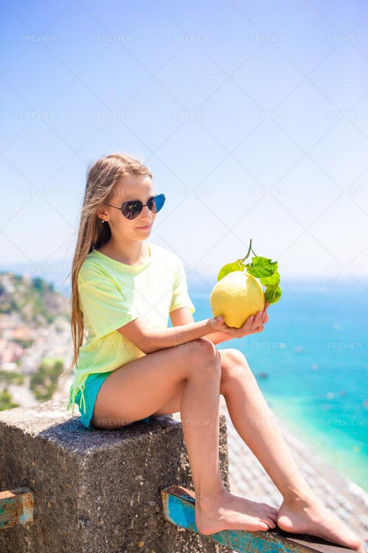 Tourist Girl With A Lemon: Stock Photos