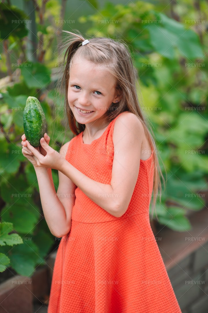 Child Shows Off Cucumber: Stock Photos