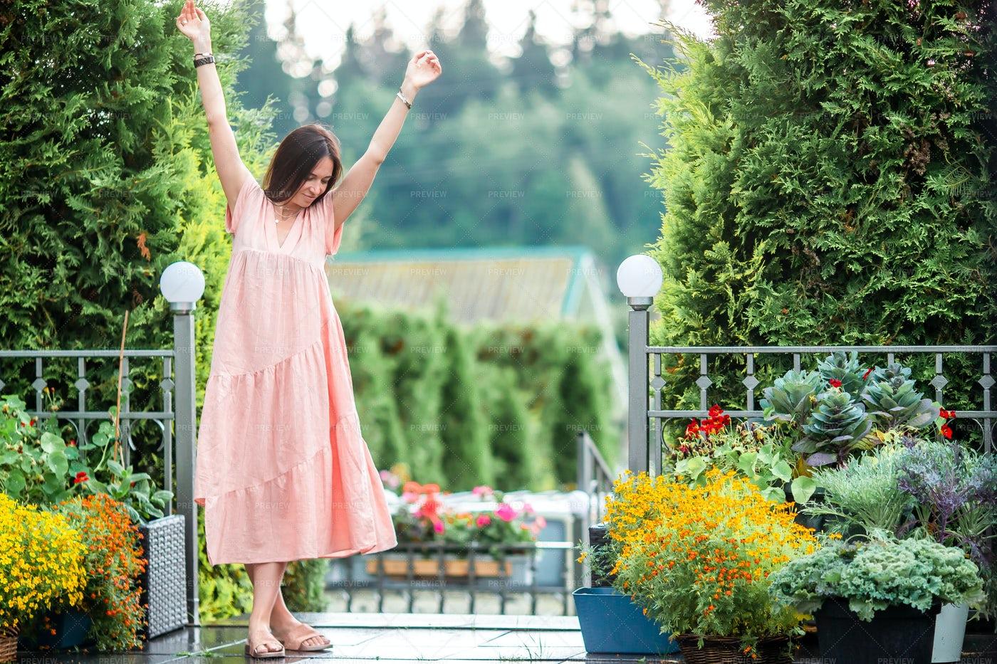 Happy Woman In A Flower Garden: Stock Photos
