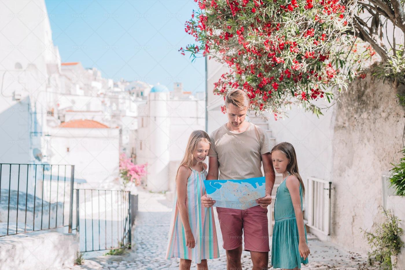 Traveling Family Checks Map: Stock Photos