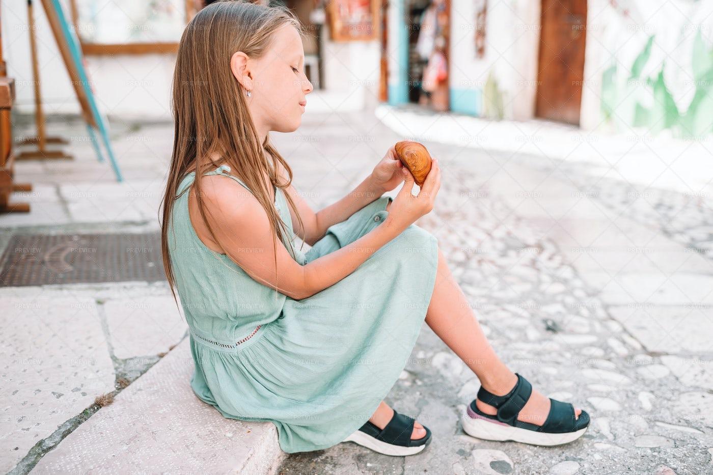 Eating A Croissant: Stock Photos