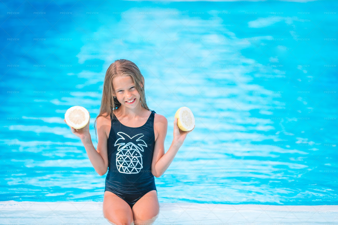 Swimming Break With Lemons: Stock Photos