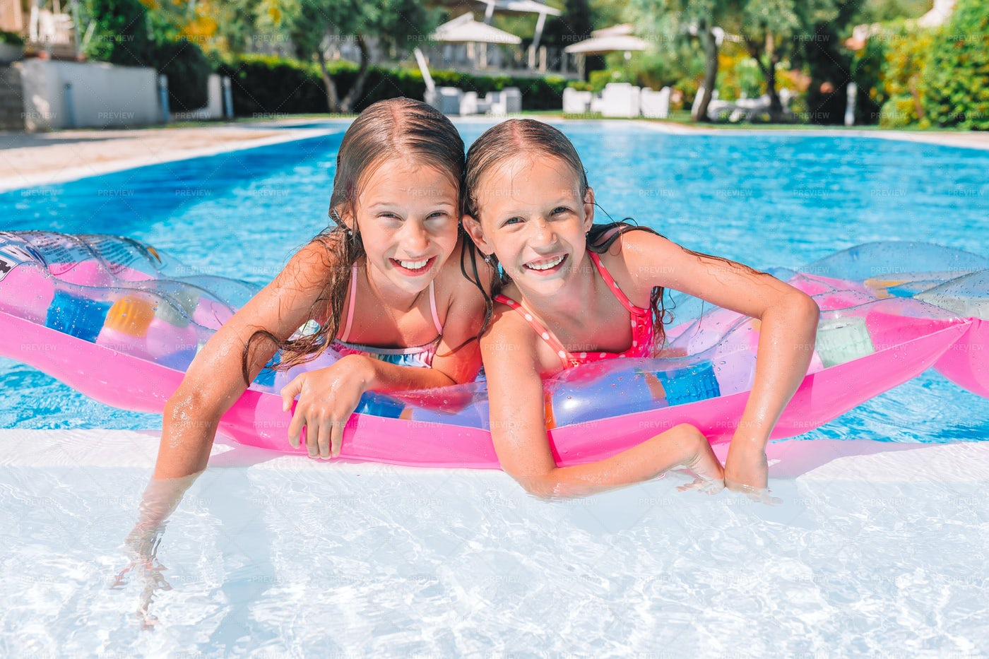 Sisters In The Pool Together: Stock Photos