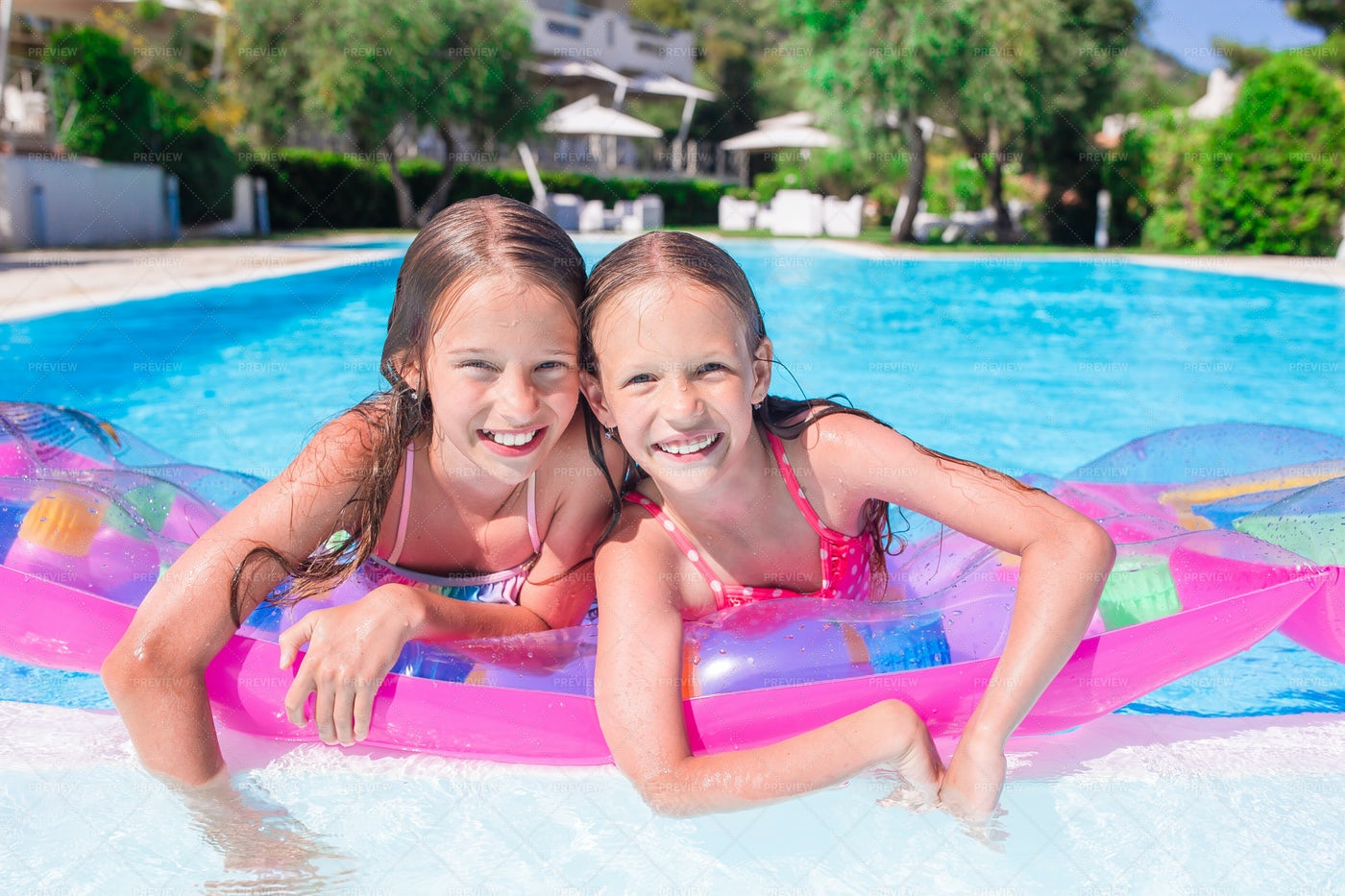 Sisters In The Pool: Stock Photos