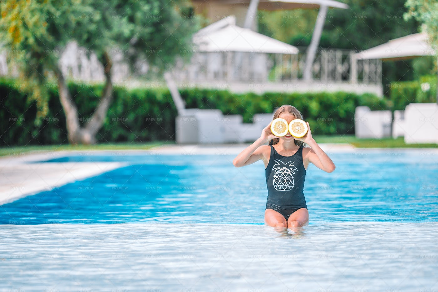 Young Swimmer With Lemons: Stock Photos