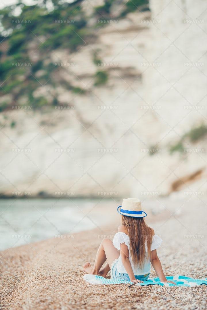 Sitting On A Beach Towel: Stock Photos