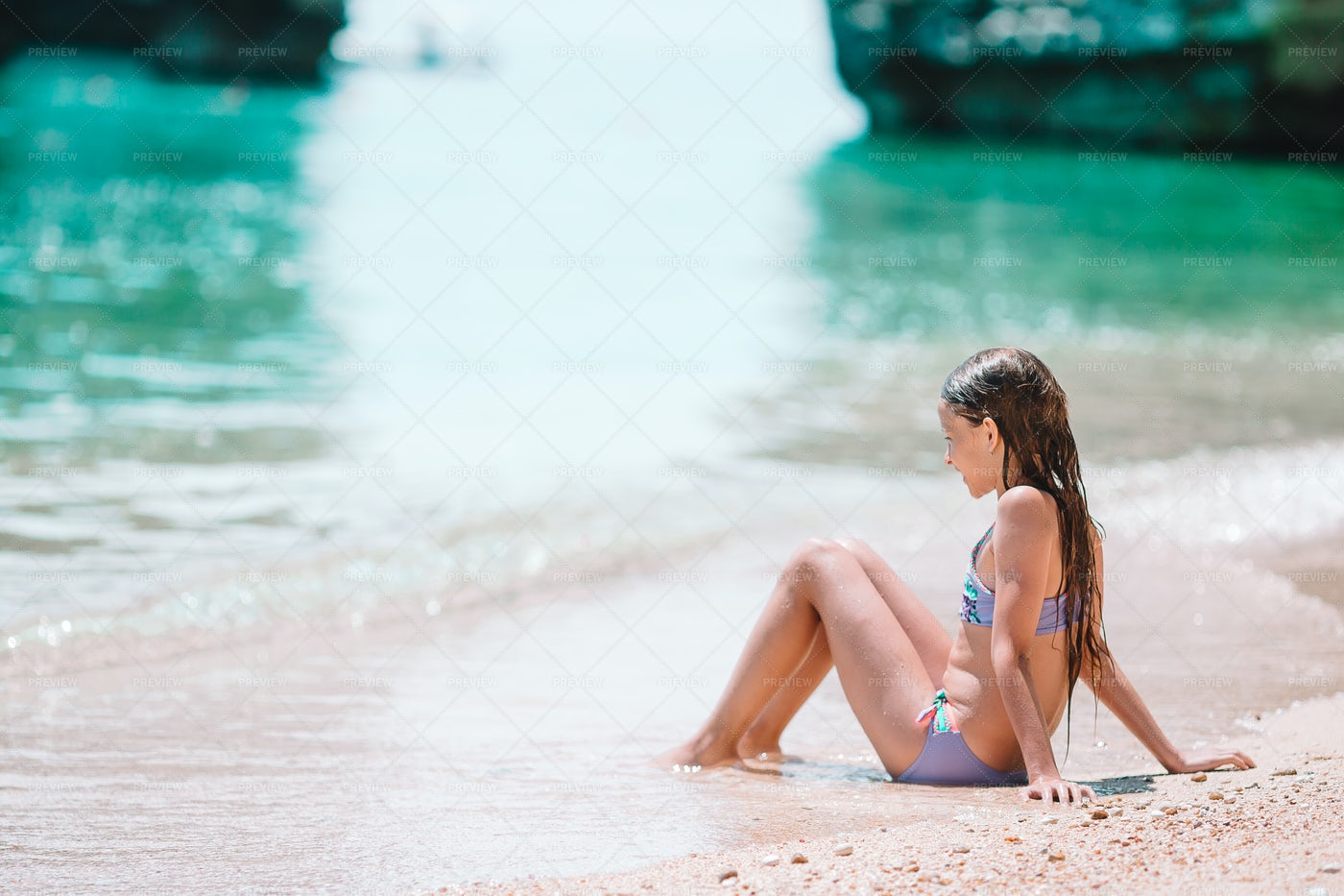 Sat In The Shallow Water: Stock Photos