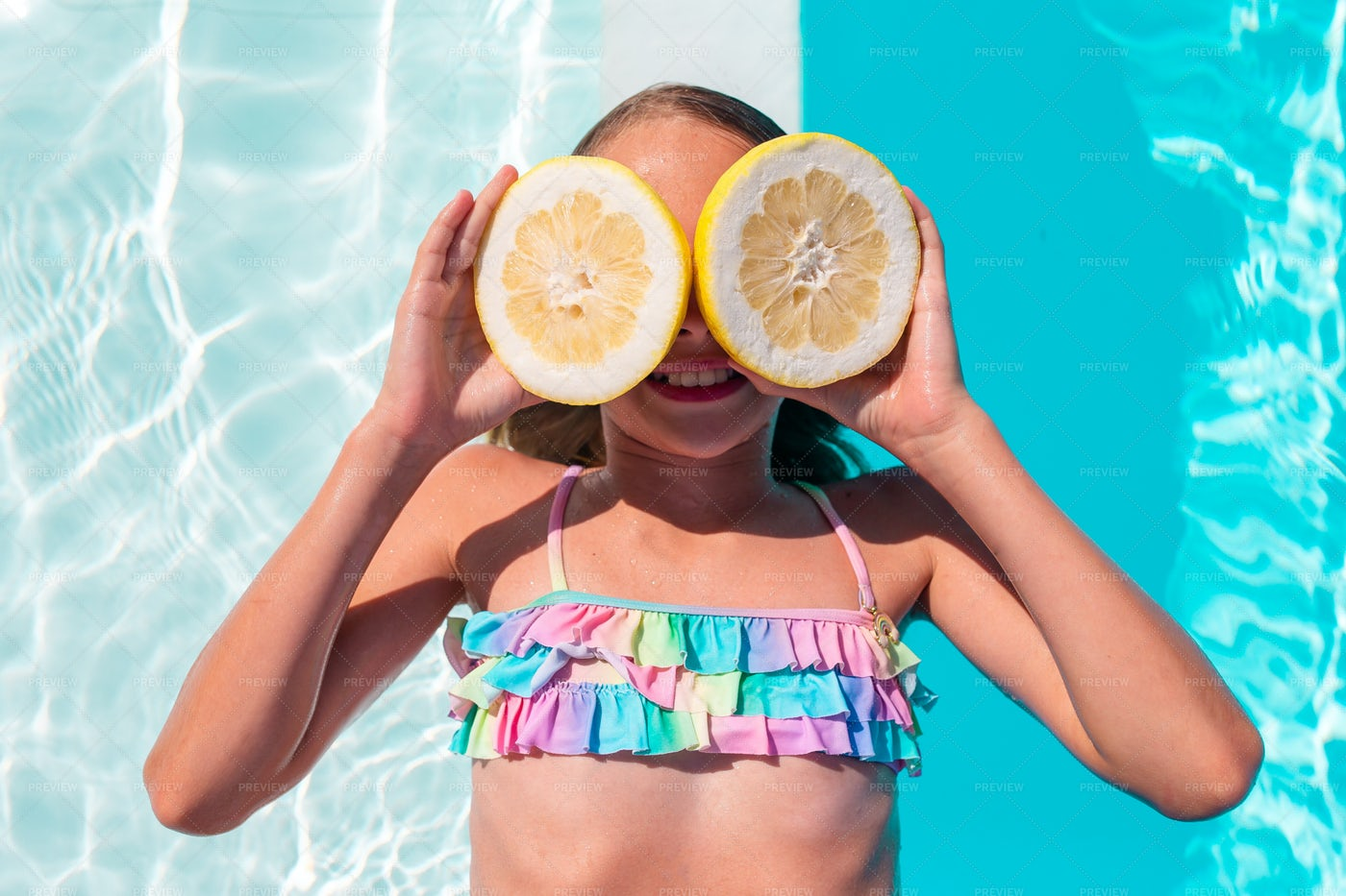 Little Kid Covering Eyes With Lemon: Stock Photos