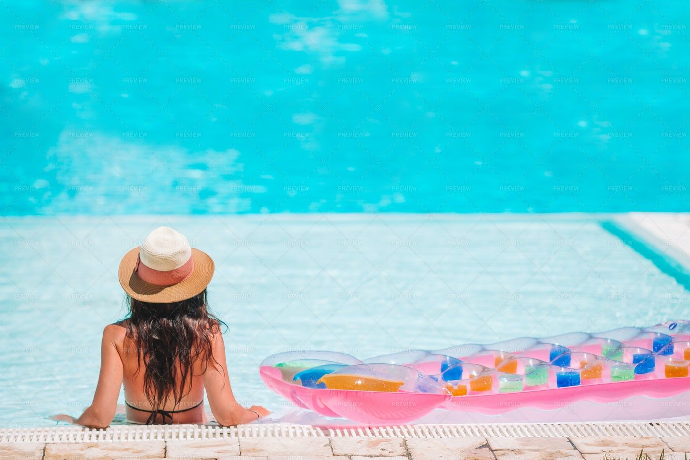 Woman Relaxing On Swimming Pool: Stock Photos