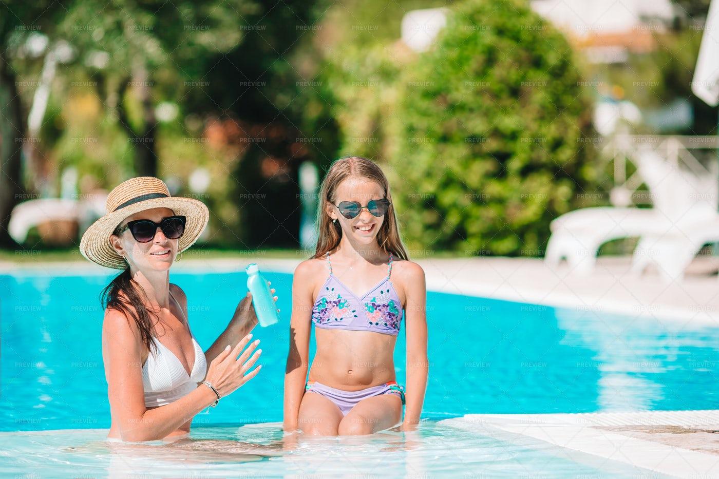 Applying Sun Cream Lotion: Stock Photos