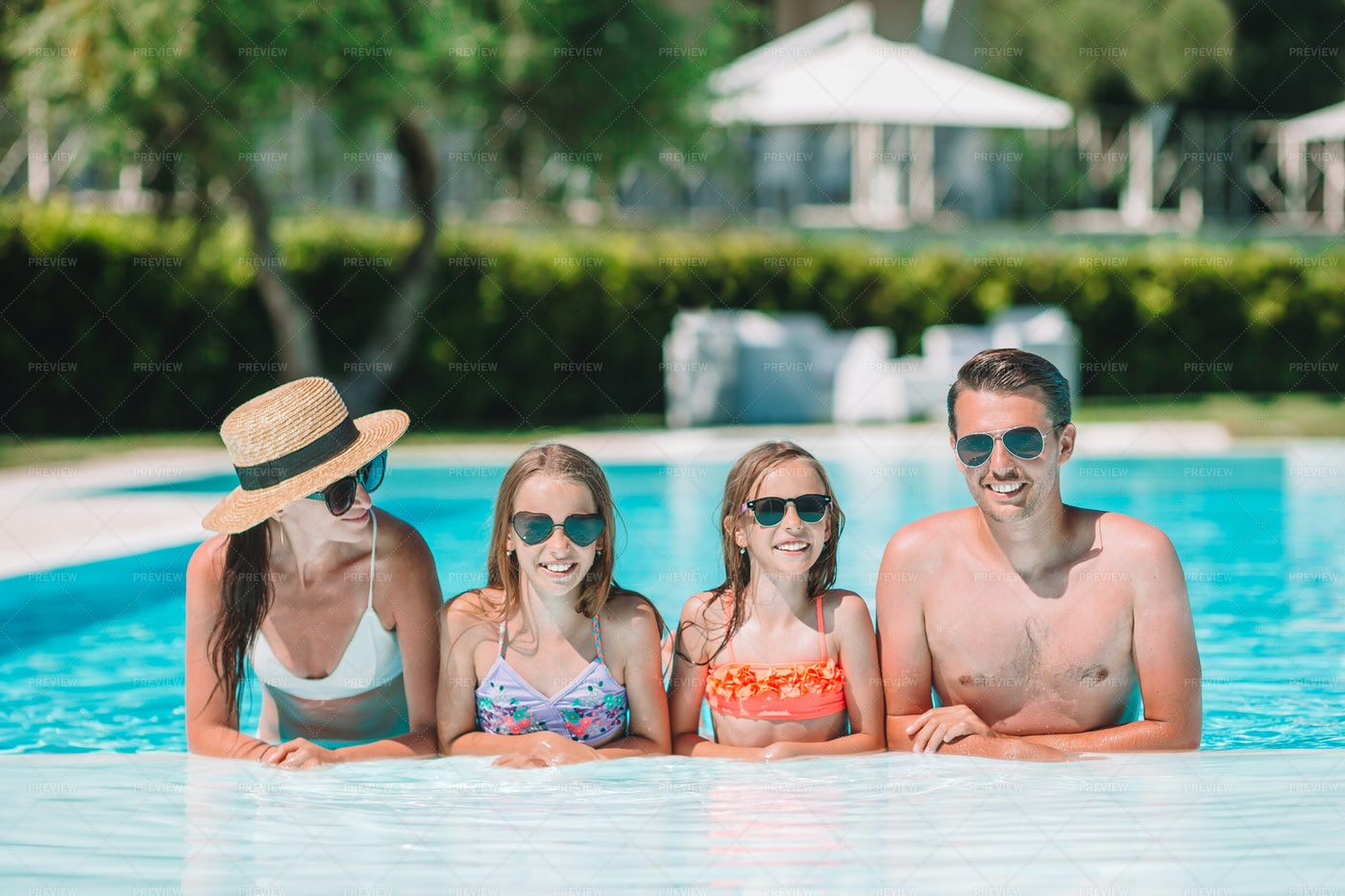 Family In A Swimming Pool: Stock Photos