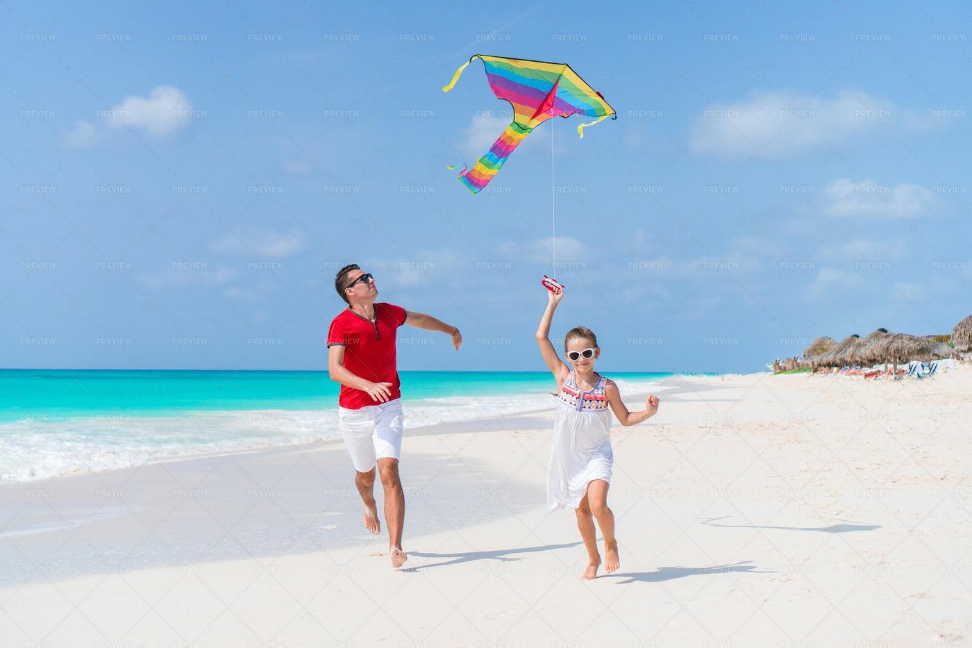 Flying A Kite On Beach: Stock Photos