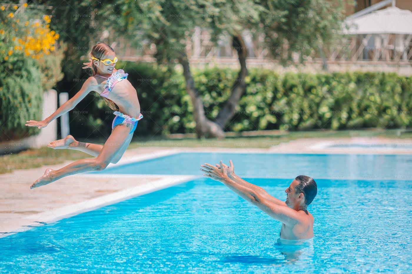 Girl Jumping Into A Pool: Stock Photos