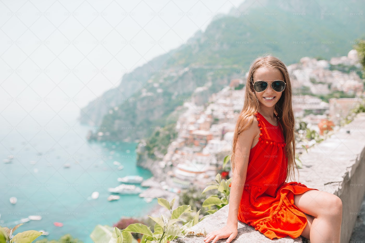 Girl With Picturesque Town At The Back: Stock Photos
