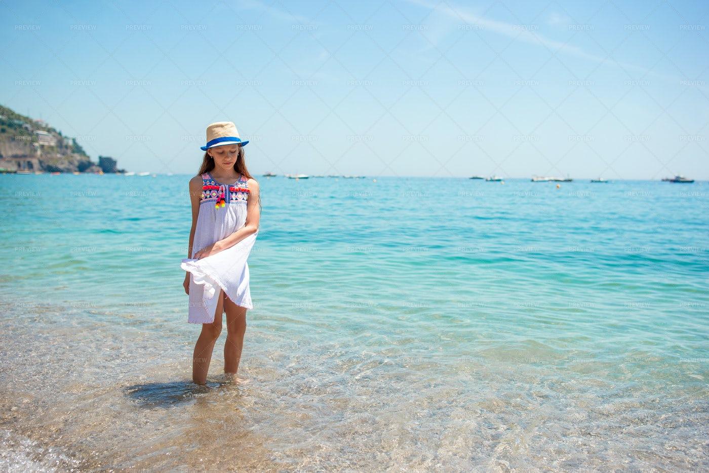 Little Girl And A Calm Beach: Stock Photos