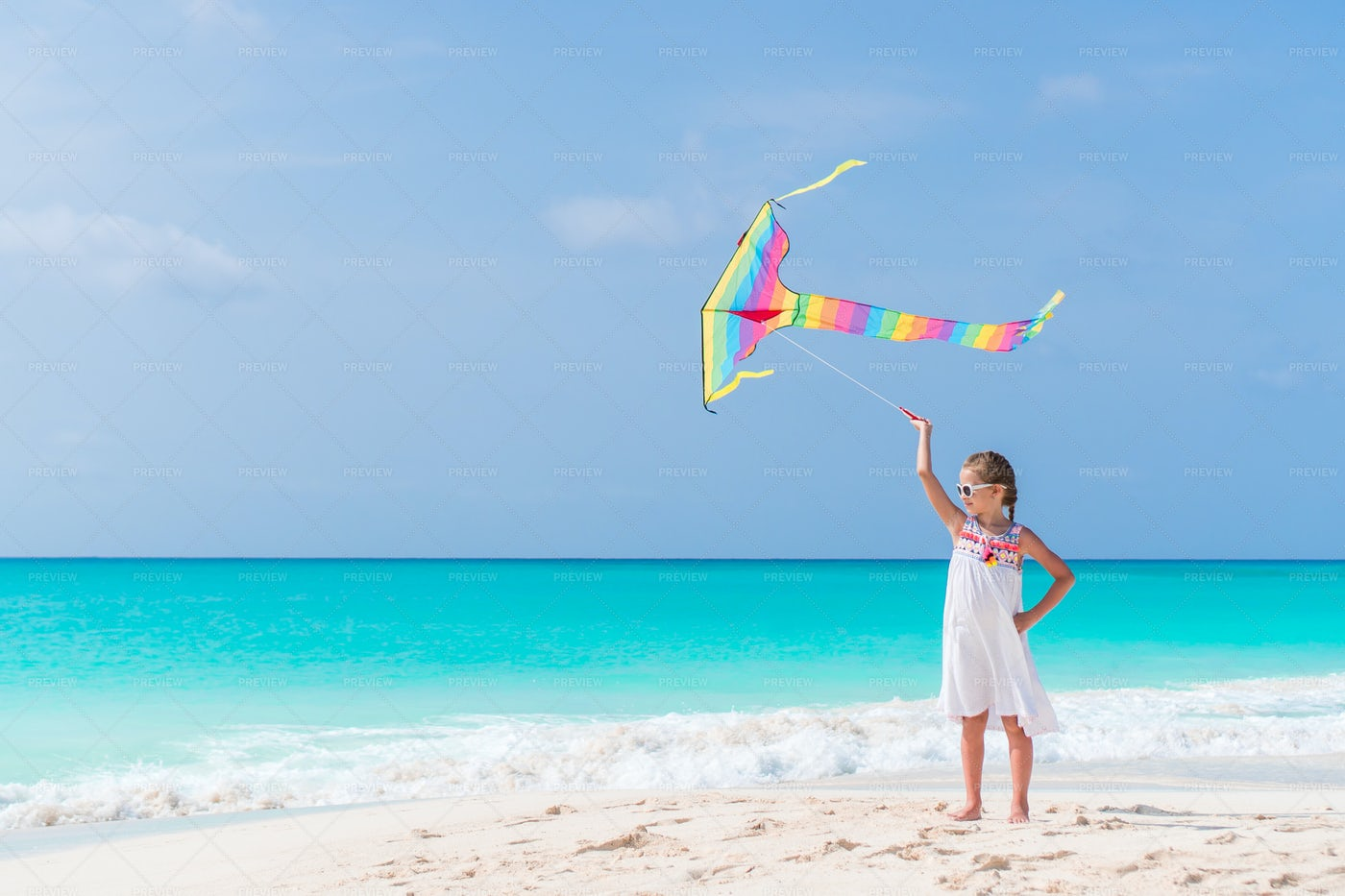 Kid Flies Colorful Kite: Stock Photos