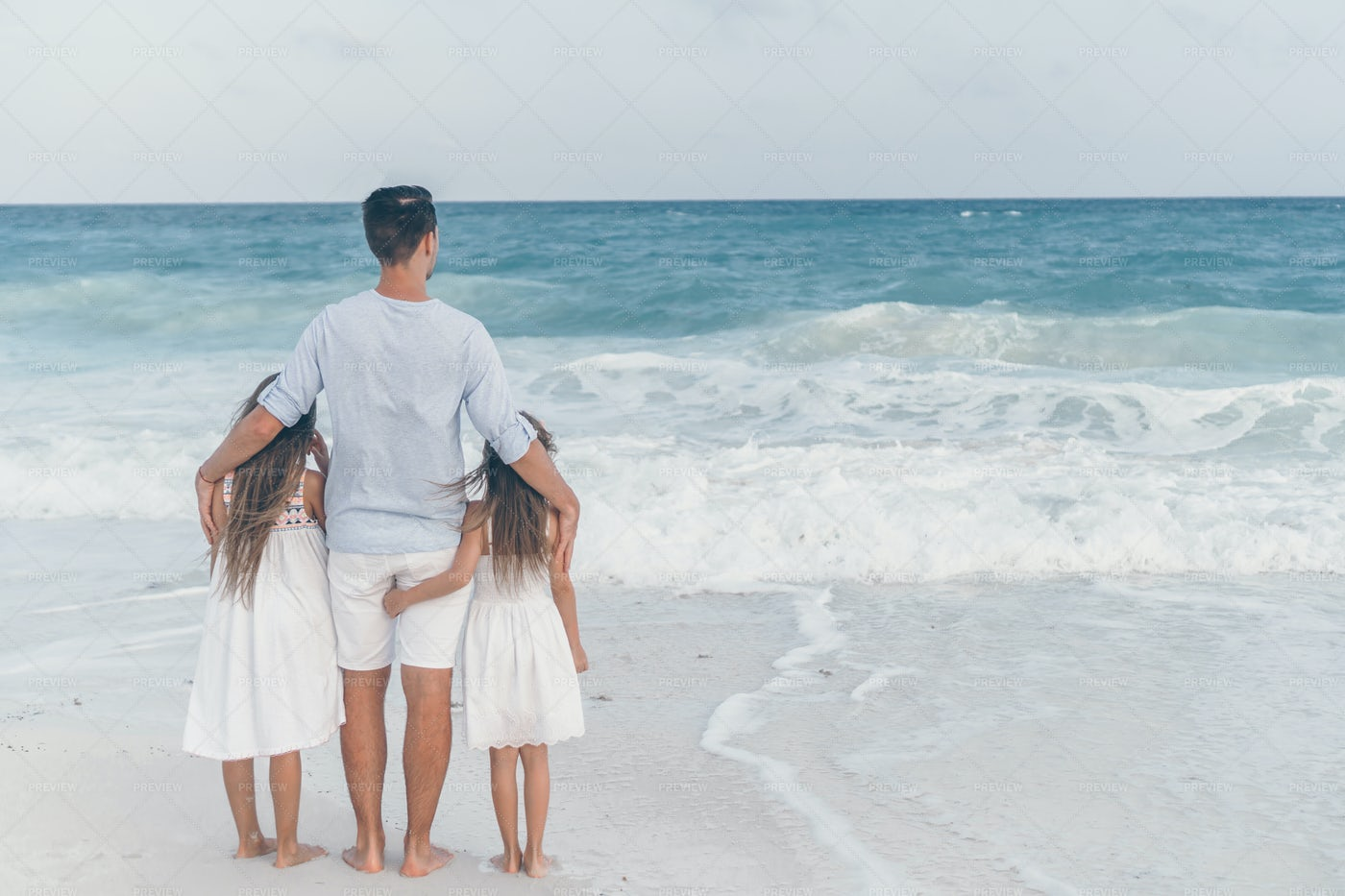 Hugging Daughters By The Water: Stock Photos