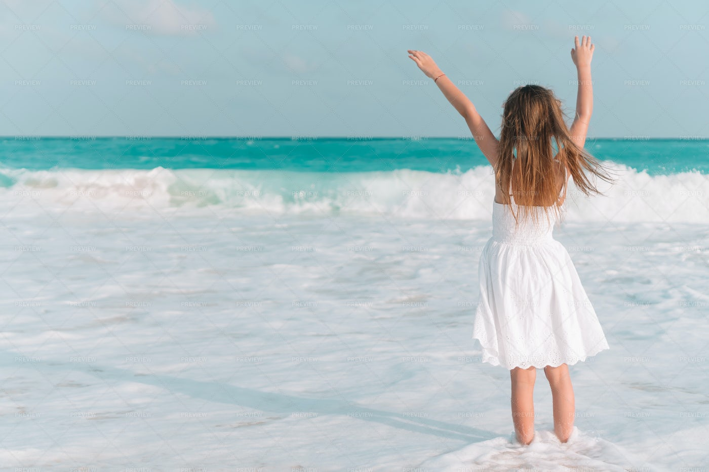 Child Standing In Shallow Surf: Stock Photos