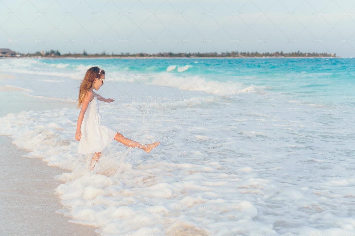 Kicking Up Water On Shore: Stock Photos