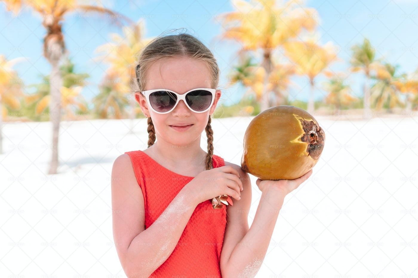 Girl With A Coconut: Stock Photos
