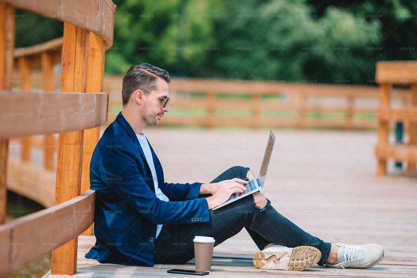 Using Laptop In A Park: Stock Photos