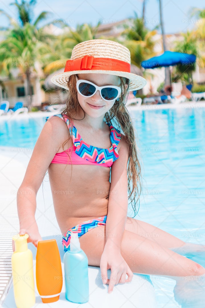 Kid With Sunscreen Bottles: Stock Photos