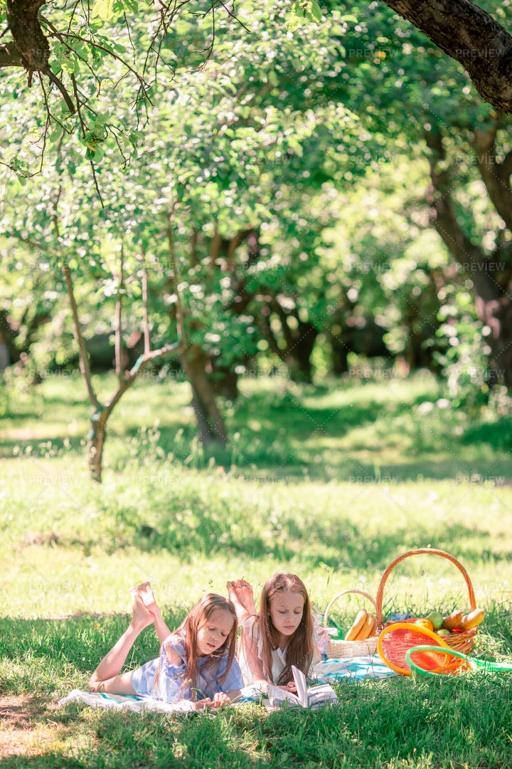 Sisters On Picnic Blanket: Stock Photos