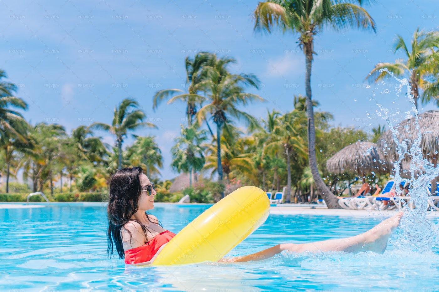 Splashing In Resort Pool: Stock Photos