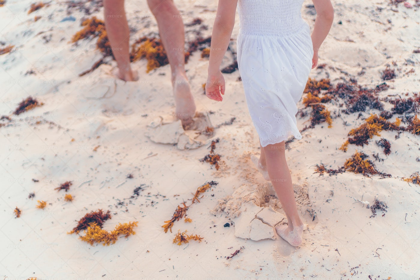 Walking Together On Sand: Stock Photos